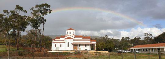 Saint Paisios Chapel beneath a rainbow